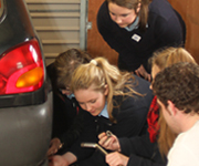 Transition Year Students changing a car wheel